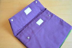 Pochette iPad - les boutons pressions