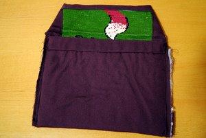 Coutures intérieures pour fermer la poche