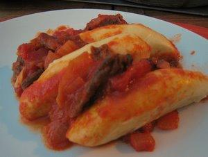 Quenelles à la sauce tomate et champignons